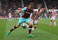 Mark Noble of West Ham United and Marc Muniesa of Stoke City in action during the Premier League match at the Bet 365 Stadium, Stoke-on-Trent.<br /> Picture by Michael Sedgwick/Focus Images Ltd +44 7900 363072<br /> 29/04/2017