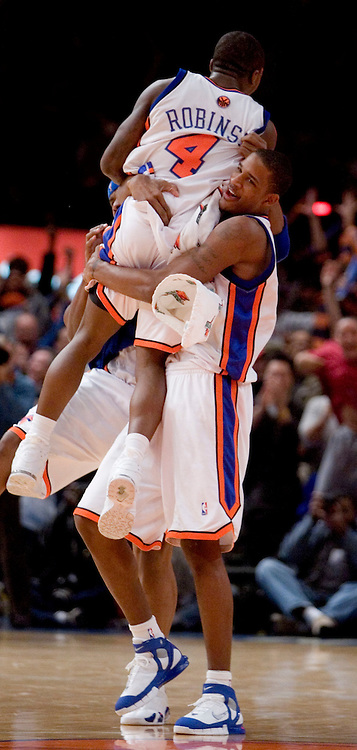 Nate Robinson jumps into the arms of Trevor Ariza of the New York Knicks after Robinson hit the game winning three point shot in overtime against the Philadelphia 76ers at Madison Square Garden in New York City.Saturday 26 November 2005. The Knicks one 105-102