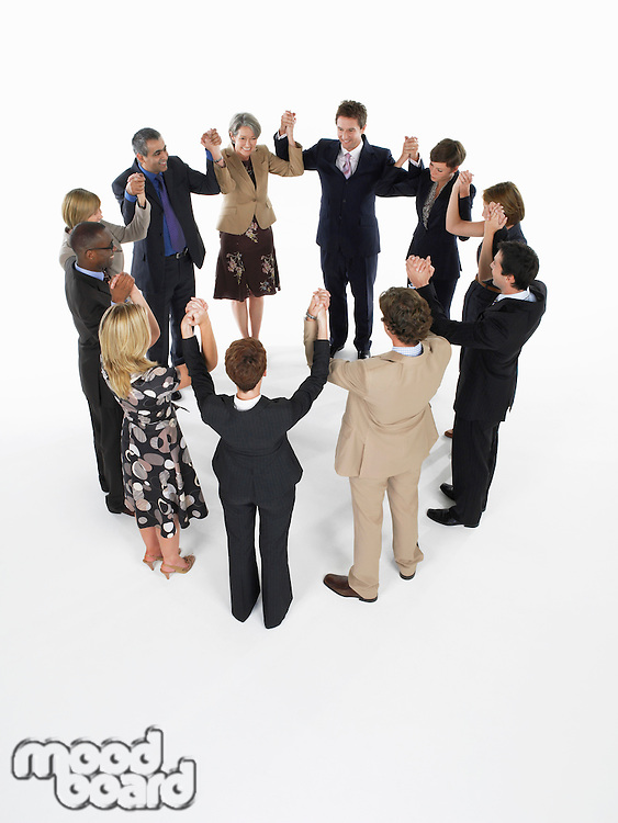 Group of Businesspeople in a circle holding hands