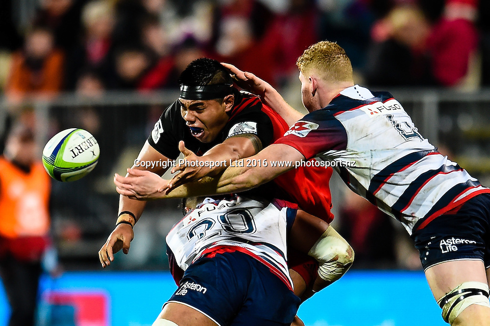 Mike Alaalatoa of the Crusaders gets the pass away in the tackle of Rob Leota  and Sam Jeffries of the Rebels  during the Super Rugby Match, Crusaders V Rebels, AMI Stadium, Christchurch, New Zealand. 9th July 2016. Copyright Photo: John Davidson / www.photosport.nz