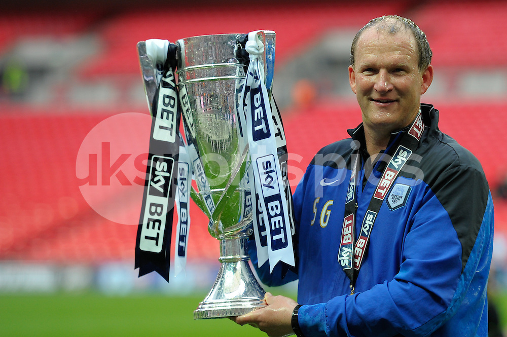 Simon Grayson manager of Preston North End with the League One Trophy after the Sky Bet League 1 Play-Off Final match between Preston North End and Swindon Town at Wembley Stadium, London, England on 24 May 2015. Photo by Salvio Calabrese.