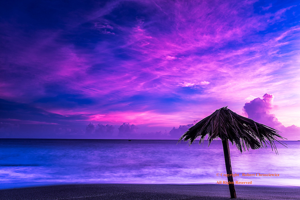 Surrealistic Colouration:  The surrealistic colouration of the sky is captured in this long exposure of the dark sand beach in Baracoa Cuba.