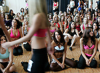 Prospective Denver Broncos cheerleaders walk in on the first day of auditions in Denver, Colorado March 25, 2007.  Over 250 women applied for the 34 slots. REUTERS/Rick Wilking (UNITED STATES)