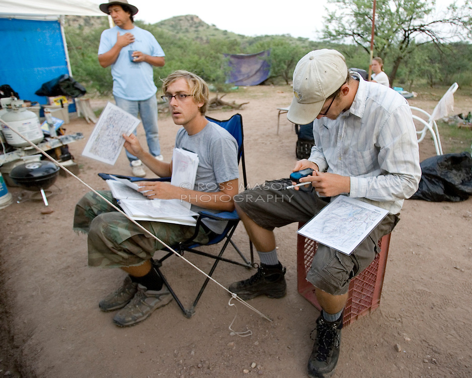 "Camp director Andrew ""Budge"" Burridge (left) and Walt Staton prepare to take the groups out on the morning patrol of the desert trails surrounding the No More Deaths camp in Southern Arizona."