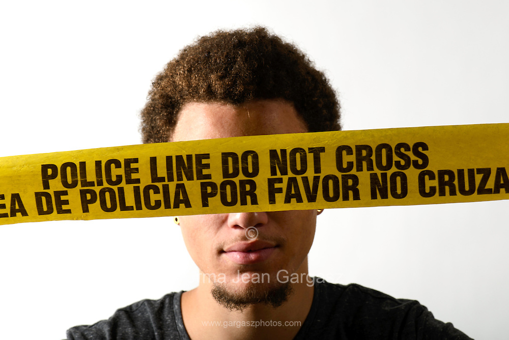A young man with crime scene tape.