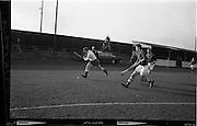 01/02/1964<br /> 02/01/1964<br /> 01 February 1964<br /> Interprovincial Mens Hockey, Ulster v Munster at Londonbridge Road, Sandymount, Dublin. R. Thornton (Ulster) prepares to cross the ball with Munster's Rolf in full chase.