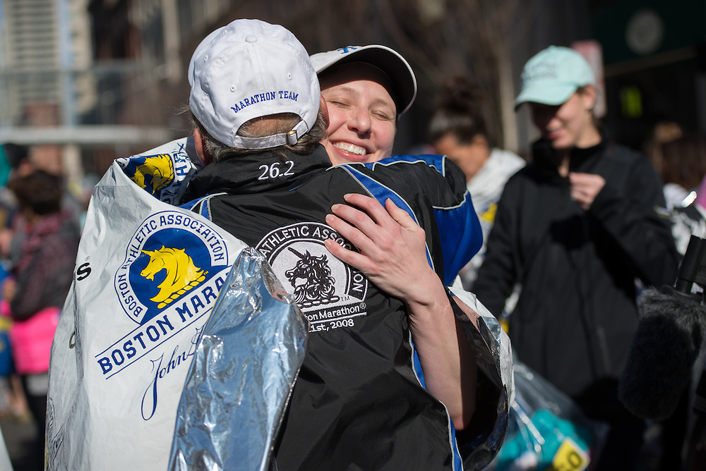 4/18/16 – Boston, MA – A Tufts Marathon Team runner Stacey Lancaster hugs Coach Donald Megerle after the finish of the 2016 Boston Marathon on April 18, 2016. (Sofie Hecht / The Tufts Daily)