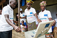 Adame Sesey, Sorieba Kargbo and Dankay Kargbo possess each one key to the metal safe from OXFAM. They provided the community this box which contains 2.000.000 SSL and a calculator for emergency well repairs in case they cannot reach someone from OXFAM. <br /> <br /> Kamanso Village in the Koinadugu District (July 19, 2016).<br /> <br /> This Community is supported by Oxfam GB and Projects are funded by the European Commission. <br /> <br /> Improving the health status of Koinadugu District through equitable water, sanitation and hygiene service delivery: The overall objective of the project is to contribute to the achievement of MDGs 4 and 7, improving health in Sierra Leone. The main problem is to be addressed by this action is the poor health status of the citizens and the link between improved health and increased access to WASH services. The causes of under 5 mortality are related to malnutrition and lack of access to adequate primary health care and infrastructure such as water and sanitation. Small sale delivery of water sanitation infrastructure and hygiene promotion services in order to identify cost-effective approaches and increase access to improved water and sanitation facilities, as well as key hygiene behaviors are among the main approaches. Also the importance of increasing the voice and influence of the communities, but in particular women, in the development planning process for WASH services.