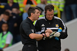 referee Lee Probert gets a boot of West Ham United's Jussi Jaaskelainen repaired during a break in play - Photo mandatory by-line: Mitchell Gunn/JMP - Tel: Mobile: 07966 386802 06/10/2013 - SPORT - FOOTBALL - White Hart Lane - London - Tottenham Hotspur V West Ham United - Barclays Premiership