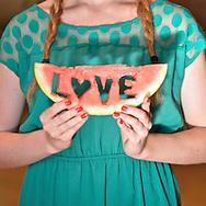 Teen with watermelon slice.  ( Kike Calvo via AP Images )