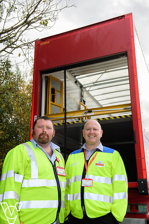 Pictured is driver Ryan Doyle, left, and Yorkshire Distribution Centre plant manager Steven Edgley with the double decker trailers.<br /> <br /> Royal Mail is rolling out 400 new double decker trailers (called 95's), which feature a rising platform to provide two layers of storage.   They are currently used for transporting Yorks, but at the end of October, Yorkshire Distribution Centre is going to use them to loose load 16,000 packages - double the current capacity of the single trailers.<br /> <br /> Picture: Chris Vaughan Photography<br /> Date: October 17, 2016