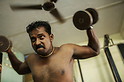 Karu Mugem, 29, works out in a small fitness club in Lallubhai Compound. The area is a resettlement for 11.000 families.