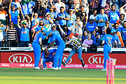 Wicket - Shikhar Dhawan of India celebrates catching Eoin Morgan of England as a over exuberant fan runs on the field during the International T20 match between England and India at the SWALEC Stadium, Cardiff, United Kingdom on 6 July 2018. Picture by Graham Hunt.