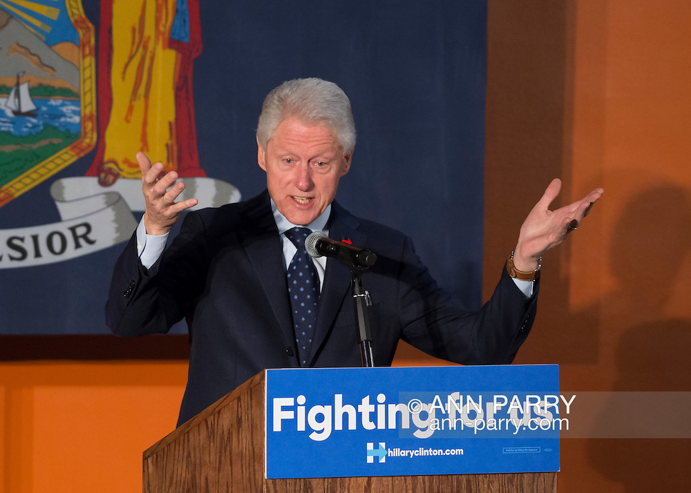 Elmont, New York, USA. April 5, 2016. Former President Bill Clinton, with his hands in wide open gesture, is the headline speaker as he campaigns at an Organizing Event rally in Elmont, Long Island, on behalf of his wife, Hillary Clinton, the leading Democratic presidential candidate, and former Secretary of State and U.S. Senator for New York. The New York Democratic Primary takes place April 19th.