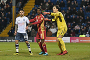 Bury Forward, Dom Telford (18), Bury Defender, Phil Edwards (14) and Bury Goalkeeper, Joe Murphy (1) during the EFL Sky Bet League 2 match between Bury and Milton Keynes Dons at the JD Stadium, Bury, England on 12 January 2019.