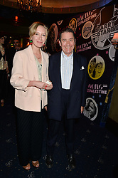 JOOLS HOLLAND and his daughter MABEL HOLLAND at The Hoping Foundation's 'Starry Starry Night' Benefit Evening For Palestinian Refugee Children held at The Cafe de Paris, Coventry Street, London on 19th June 2014.