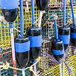 Lobster buoys and traps on the wharf at Potts Harbor Lobster in Harpswell, Maine.