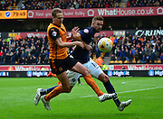 Dave Edwards and Mark Beevers battle for the ball during the Sky Bet Championship match between Wolverhampton Wanderers and Millwall at Molineux, Wolverhampton, England on 2 May 2015. Photo by Alan Franklin.