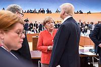 07 JUL 2017, HAMBURG/GERMANY:<br /> Angela Merkel (L), CDU, Bundeskanzlerin, und Donald Trump (R), Praesident Vereinigte Staatsn von America, USA, im Gesprech, vor Beginn der 1. Arbeitssitzung, G20 Gipfel, Messe<br /> IMAGE: 20170707-01-017<br /> KEYWORDS: G20 Summit, Deutschland, Gespr&auml;ch