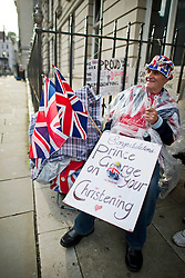 © London News Pictures. 22/10/2013 . London, UK.  Royal die-hard fan Terry Hutt waiting outside the main entrance to St James's Palace in London ahead of the Christening of royal baby Prince George, which is due to take place at the Palace chapel tomorrow (Wed). Photo credit : Ben Cawthra/LNP