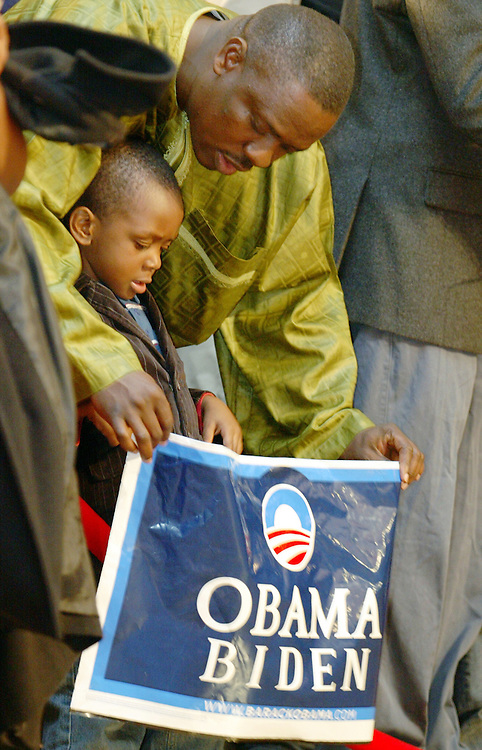 Enoh Johnson, 38, and his son Enoh Johnson Jr., 3, show their support for Barack Obama during Massachusetts Senator John Kerry's victory celebration at the Fairmont Copley Plaza hotel on election night, November 4, 2008, in Boston, MA...(Photo by Brooks Canaday)