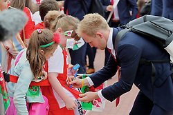 CARDIFF, WALES - Saturday, June 4, 2016: Wales' Jonathan Williams signs autographs for school children as the team arrive at Cardiff Airport ahead of the team's departure to Sweden and onto the European Championships 2016 in France. (Pic by David Rawcliffe/Propaganda)