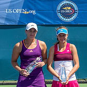 August 16, 2014, New Haven, CT:<br /> Michaela Gordon and Caitlin Whoriskey pose for a photograph with the trophies after playing each other in the 2014 US Open National Playoffs Women's final match on day four of the 2014 Connecticut Open at the Yale University Tennis Center in New Haven, Connecticut Monday, August 18, 2014.<br /> (Photo by Billie Weiss/Connecticut Open)