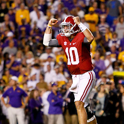 November 3, 2012; Baton Rouge, LA, USA; Alabama Crimson Tide quarterback AJ McCarron (10) celebrates after throwing a game winning touchdown pass to running back T.J. Yeldon (4) against the LSU Tigers during the fourth quarter of a game at Tiger Stadium. Alabama defeated LSU 21-17. Mandatory Credit: Derick E. Hingle-US PRESSWIRE