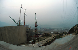 CHINA HUBEI PROVINCE THREE GORGES DAM MAY99 - A view on the construction site of the Three Gorges Dam. Seven large cities, including Chongquing, and thousands of villages will be submerged once the water level rises after the completion of the controversial Three Gorges Dam project further downriver. The flooding of areas reaching back more than 550Km upriver will require the evacuation and resettlement of more than 10 million people.  jre/Photo by Jiri Rezac. . © Jiri Rezac 1999. . Tel:   +44 (0) 7050 110 417. Email: info@jirirezac.com. Web:   www.jirirezac.com
