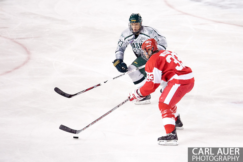 October 13, 2007 - Anchorage, Alaska:  In the battles of 33's, Colin Wilson (red) of the Boston University Terriers brings the puck up the ice with Alaska's Mat Robinson (33) on defense during game 4 of the Nye Frontier Classic at the Sullivan Arena.  UAA and BU would tie 4-4 giving Robert Morris University the title of Nye Frontier Classic Champion.