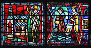 Fulbert in front of the completed cathedral (left) (this is an imagined scene as Fulbert died in 1028, 9 years before the completion of the rebuilding), and Cnut, King of Denmark, sending his servant with alms to Chartres, from the Life of Fulbert stained glass window, in the south transept of Chartres Cathedral, Eure-et-Loir, France. This window replaces the original 13th century window depicting the Life of St Blaise, which was destroyed in 1791. It was created in 1954 by Francois Lorin as a gift of the Institute of American Architects, on a theme chosen by the Canon Yves Delaporte. It depicts the life of Fulbert, bishop of Chartres in the 11th century. Chartres cathedral was built 1194-1250 and is a fine example of Gothic architecture. Most of its windows date from 1205-40 although a few earlier 12th century examples are also intact. It was declared a UNESCO World Heritage Site in 1979. Picture by Manuel Cohen