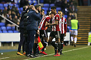 Brentford Oliver Watkins (11) replaced by  Brentford Sergi Canos (47) during the EFL Sky Bet Championship match between Reading and Brentford at the Madejski Stadium, Reading, England on 20 January 2018. Photo by Gary Learmonth.