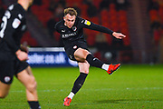 Cauley Woodrow of Barnsley (9) shoots during the EFL Sky Bet League 1 match between Doncaster Rovers and Barnsley at the Keepmoat Stadium, Doncaster, England on 15 March 2019.