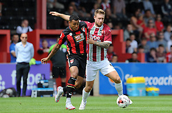 Exeter City's David Noble challenges for the ball with Bournemouth's Josh King. - Photo mandatory by-line: Harry Trump/JMP - Mobile: 07966 386802 - 18/07/15 - SPORT - FOOTBALL - Pre Season Fixture - Exeter City v Bournemouth - St James Park, Exeter, England.