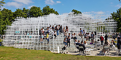 © Licensed to London News Pictures.  08/06/2013. LONDON, UK. Opening day of the Serpentine Gallery Pavilion 2013, designed by architect Sou Fujimoto (not pictured).  Occupying some 350 square-metres of lawn in front of the Serpentine Gallery, the latticed structure is made of 20mm steel poles. Designed as a flexible, multi-purpose social space - with a café sited inside - visitors will be encouraged to enter and interact with the Pavilion in different ways throughout its four-month tenure in Hyde Park. Photo credit: Cliff Hide/LNP