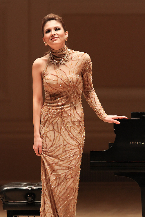 "NEW YORK - JANUARY 19:  Pianist Lola Astanova performs ""A Tribute to Horowitz"" presented by the American Cancer Society at Carnegie Hall on January 19, 2012 in New York City.  (Photo by Matthew Peyton/Getty Images) *** Local Caption *** Lola Astanova"