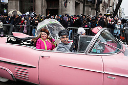 © Licensed to London News Pictures. 01/01/2014. London, United Kingdom. Thousands of people have been taking part in London's traditional New Year's Day parade, which this year celebrates the swinging 60s. The traditional London New Year's Day Parade followed a route through the streets of London in heavy rain. Photo credit : Andrea Baldo/LNP