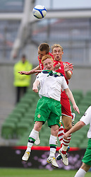 DUBLIN, REPUBLIC OF IRELAND - Friday, May 27, 2011: Wales' Danny Collins and Jack Collison challenge and Northern Ireland's Robert Garrett during the Carling Nations Cup match at the Aviva Stadium (Lansdowne Road). (Photo by David Rawcliffe/Propaganda)