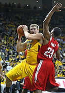 January 27, 2010: Iowa forward/center Brennan Cougill (44) pulls down a rebound in front of Ohio State guard/forward David Lighty (23)  during the first half of their game at Carver-Hawkeye Arena in Iowa City, Iowa on January 27, 2010. Ohio State defeated Iowa 65-57.