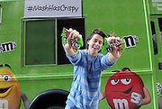 Social media star Nash Grier helps hand out M&M'S Crispy in New York, Thursday, July 16, 2015, after accepting a challenge from Mars Chocolate North America to give away 1 million tastes in just one day.  The event celebrates the return of M&M'S Crispy, which recently returned to shelves after a massive outpouring from fans demanding its return.   (Photo by Diane Bondareff/Invision for Mars Chocolate North America/AP Images)