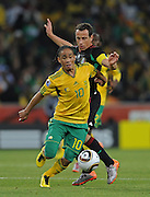 FIFA SOCCER WORLD CUP 2010, SOCCER CITY in SOWETO, 11 June 2010. Midfielder on Bafana, Steven PIENAAR wins control of the ball from Midfielder of Mexico, Gerardo TORRADO during the Opening match, Match#1 between South Africa and Mexico at SOCCER CITY Stadium in Soweto, Johannesburg, South Africa on 11 June 2010.<br /> Photographer : Anton de Villiers / SPORTZPICS