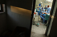 Plastic surgeons Dr. Lam Hoai Phuong (foreground) of Vietnam and Dr. Ken Wilson (rear) of Halifax, Canada operate on patients in the operating theatre of the Black Lion Hospital in Addis Ababa, Ethiopia on Tuesday, December 6, 2005. The surgeons were in Ethiopia's capital city volunteering their time with an international medical team during Operation Smile's inaugural mission to Ethiopia. Operation Smile is the Norfolk, VA based medical organization that provides free facial reconstructive surgery to children and young adults in 24 countries.