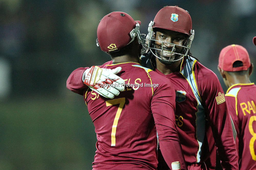 Chris Gayle of The West Indies and Marlon Samuels of The West Indies celebrate the win during the ICC World Twenty20 Super Eights match between The West Indies and New Zealand held at the  Pallekele Stadium in Kandy, Sri Lanka on the 1st October 2012<br /> <br /> Photo by Ron Gaunt/SPORTZPICS/PHOTOSPORT