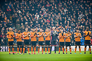 Wolves players acknowledge a minutes applause ahead of the EFL Sky Bet Championship match between Wolverhampton Wanderers and Nottingham Forest at Molineux, Wolverhampton, England on 20 January 2018. Photo by Darren Musgrove.