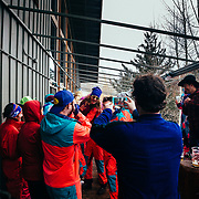 Twenty Canadians toss Heather Goodrich up in the air apres ski at the Mangy Moose in Teton Village, Wyoming.