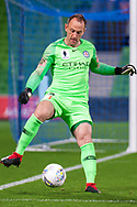 Melbourne City goalkeeper Eugene Galekovic (18) controls the ball at the FFA Cup Round 16 soccer match between Melbourne City FC v Newcastle Jets at AAMI Park in Melbourne.