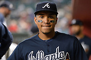 PHOENIX, AZ - JULY 26:  Johan Camargo #17 of the Atlanta Braves reacts in the dugout prior to the MLB game against the Arizona Diamondbacks at Chase Field on July 26, 2017 in Phoenix, Arizona.  (Photo by Jennifer Stewart/Getty Images)