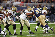 ST. LOUIS - SEPTEMBER 23:  Defensive tackle Damione Lewis #92 of the St. Louis Rams was thrown out of the game for unsportsmanlike conduct after a play in which he blocked and hit offensive guard Kendyl Jacox #64 of the New Orleans Saints at the Edward Jones Dome on September 23, 2005 in St. Louis, Missouri. The Rams defeated the Saints 28-17. ©Paul Anthony Spinelli *** Local Caption *** Damione Lewis;Kendyl Jacox