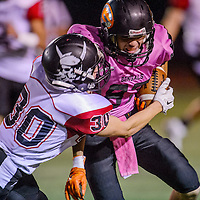 Gallup Bengal Johnny Blueeyes (87) clashes with Grants Pirate Braman Merayo (30) Saturday at Public School Stadium in Gallup.