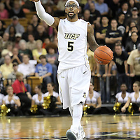 Central Florida guard Marcus Jordan (5) gives instructions during a Conference USA NCAA basketball game between the Marshall Thundering Herd and the Central Florida Knights at the UCF Arena on January 5, 2011 in Orlando, Florida. Central Florida won the game 65-58 and extended their record to 14-0.  (AP Photo/Alex Menendez)